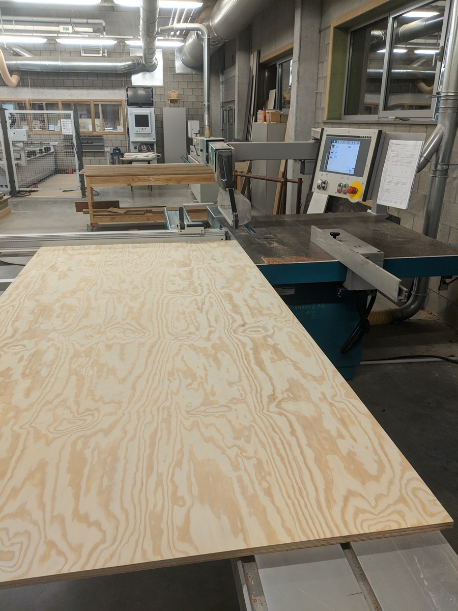 Full sheet of plywood on the table saw