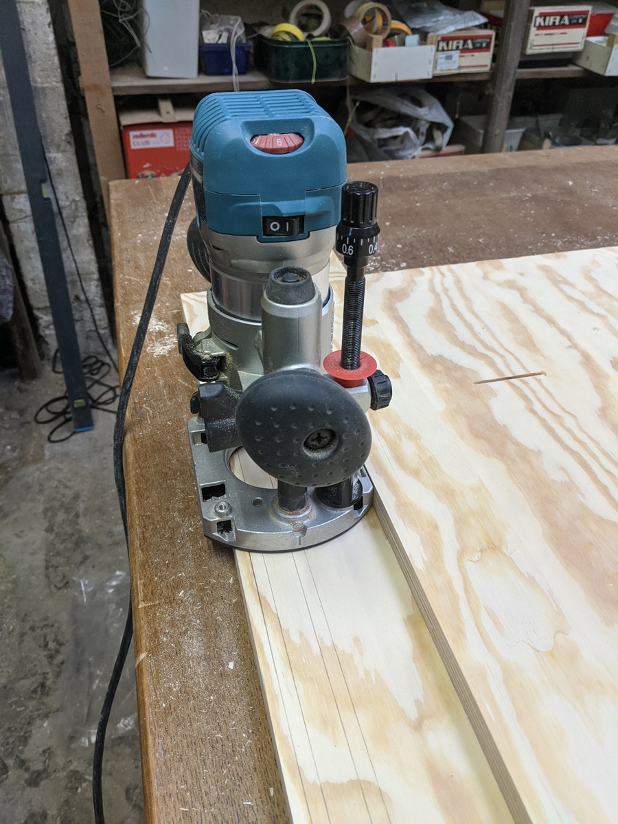 Routing grooves with my Makita router, dust all over the place